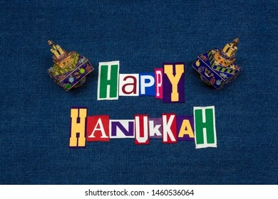 HAPPY HANUKKAH word text collage with colorful dreidels, multi colored fabric on blue denim, Jewish holiday, horizontal aspect