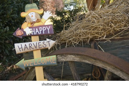 Happy Harvest Scarecrow Sign on Hay Wagon