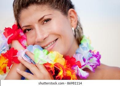 Happy Hawaiian woman enjoying her holidays at the beach