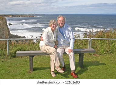 Happy and Healthy at 80 couple enjoy a day out at the English coastline