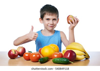 Happy healthy boy with fruits and vegetables isolated white