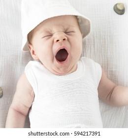 happy healthy cute newborn baby on blanket at beach