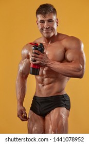 Happy and healthy muscular young fitness sports man, bodybuilder with a jar of sports nutrition - protein, gainer and casein