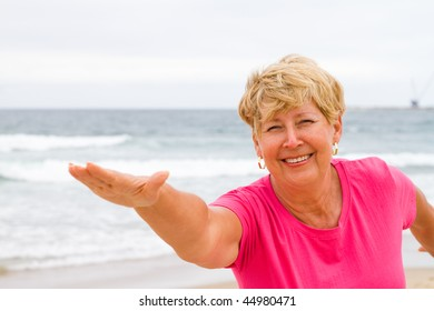 happy and healthy senior woman exercise on beach