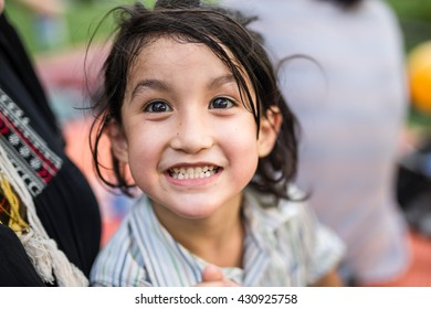 Happy healthy sweaty hair sweet face 5 years old kid,boy,child smile and acting face at play time in the park,in hot summer holiday with toned color and selective focus