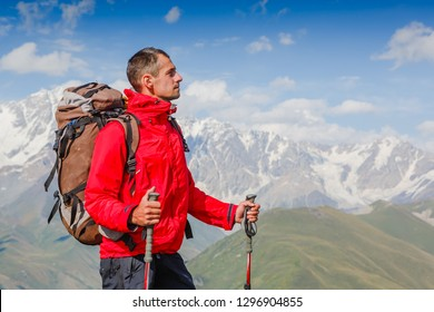 Happy hiker enjoying the view. Caucasus Mountains