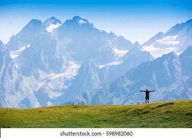 Happy hiker enjoying the view. Caucasus Mountains