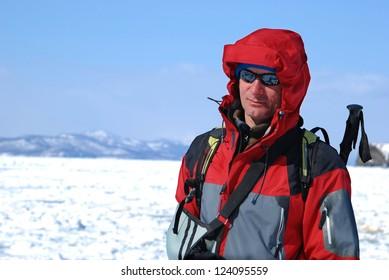 Happy hiker in Kamchatka. The Pacific coast.