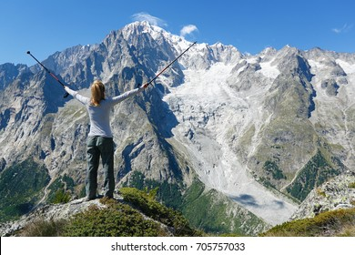 Happy hiker at mountain top. Mont Blanc Courmayeur, Italy