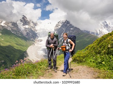 Happy hiker relax on beautiful mountains landscape in sunny day