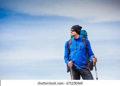 Happy hiker walking in the mountains. Freedom and happiness, achievement concept