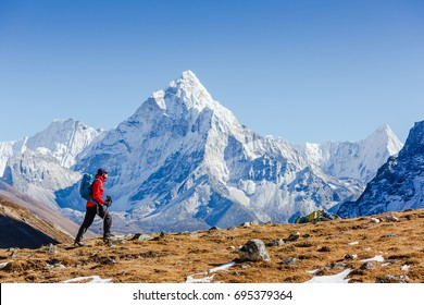 Happy hiker walking in the mountains. Himalayas, Everest Base Camp trek, Nepal