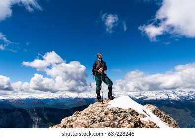 Happy hiker winning reaching life goal, success, freedom and happiness, achievement in mountains. Alps Europe
