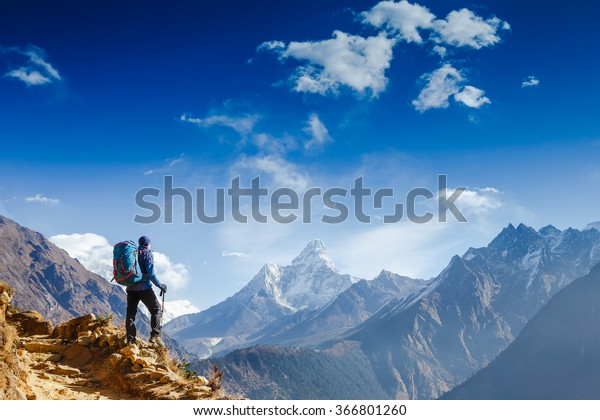 Happy hiker winning reaching life goal, success, freedom and happiness, achievement in mountains. Himalayas. Nepal