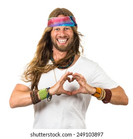 Happy hippie man holding his hands in a love heart over his chest. Isolated on white.