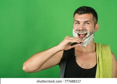 happy hipster in barbershop, new technology. Man cut beard and mustache with razor and shaving gel. Barber and hairdresser. Haircut of bearded man, archaism. Fashion and beauty, innovation.