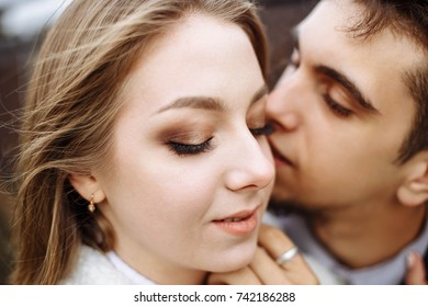 Happy hipster couple on holiday having fun and enjoy the time. Couple in love kissing and hugging. Shallow depth of field.