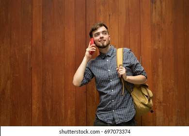 Happy hipster man backpack in wood background, Relax time on holiday concept travel , color of vintage tone and soft focus