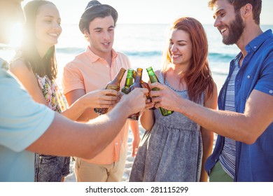 Happy hipsters toasting at the beach