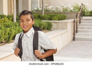 Happy Hispanic Boy with Backpack Walking on School Campus.