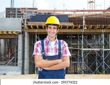 Happy hispanic construction worker at building site