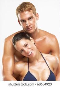 Happy hispanic couple after bath-spa. Hispanic couple on white background.