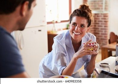 Happy Hispanic couple in kitchen in the morning, close up