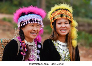 Happy Hmong hill tribe women in colorful costume dress portrait