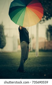 happy and holding umbrella in the background, Enjoyable life in nature, daisy girl