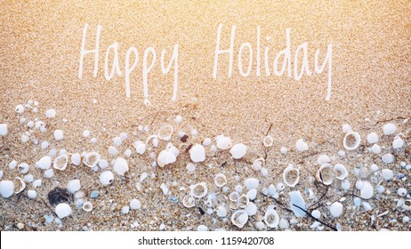 Happy Holiday on sandy beach and seashells background