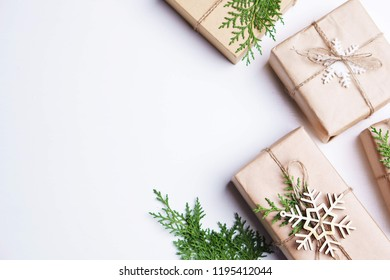 Happy holidays. Beautiful greeting card, Christmas and New Year background, celebration concept.Gift boxes with festive decorations on white table, copy space