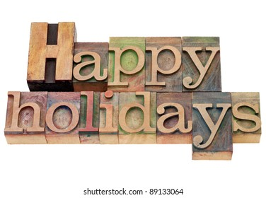 happy holidays - isolated text in vintage wood letterpress printing blocks