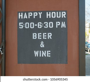 Happy hour, wine and beer, sign outdoors. 5:30 to 6:30 PM