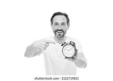 Happy hours. Personal schedule and daily regime. Alarm clock morning time. Time management skills. Man bearded mature guy hold clock isolated on white. Man with beard check what time is it.