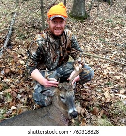Happy hunter with an eight point Whitetail Buck harvested in a Wisconsin gun season