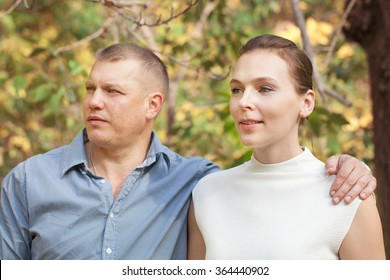 Happy husband hugging wife in autumn park, portrait, outdoor, fall