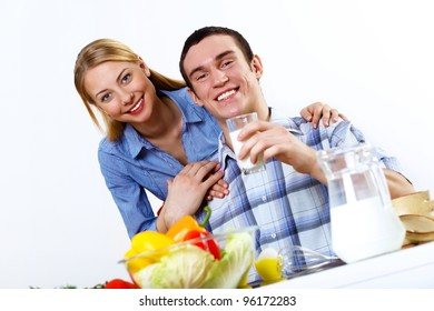 Happy husband and wife cooking together at home