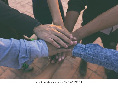 Happy image of  business people Teamwork Concept,Group of diversity people putting their hands together ,hand a young business people join hands partnership teamwork concept