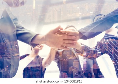 Happy image of  businesspeople Teamwork Concept,Group of diversity people putting their hands together ,hand a young business people join hands partnership teamwork concept