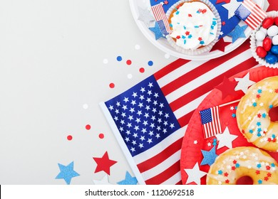 Happy Independence Day 4th july background with american flag decorated of sweet foods, stars and confetti. Holidays table top view.