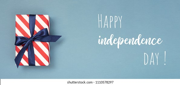 Happy Independence Day card with gift box in national colors and text. Conceptual idea for banner.