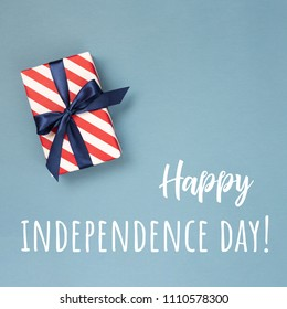 Happy Independence Day card with gift box in national colors and text. Conceptual idea.