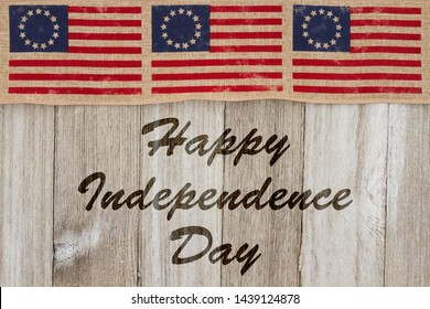Happy Independence Day greeting, USA patriotic old Betsy Ross flag and weathered wood background with text Happy Independence Day