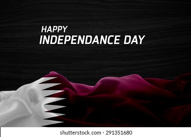 Happy Independence Day Qatar flag and wood background