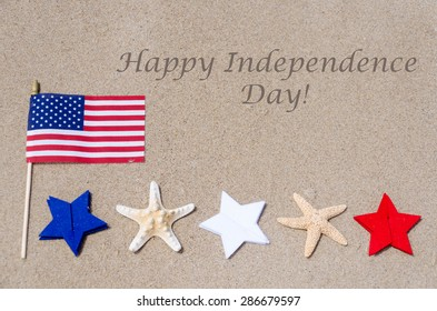 Happy Independence Day USA background on the sandy beach (4th of july holiday concept)