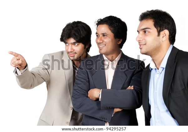 happy Indian business team,happy business team looking and pointing towards left side out of frame