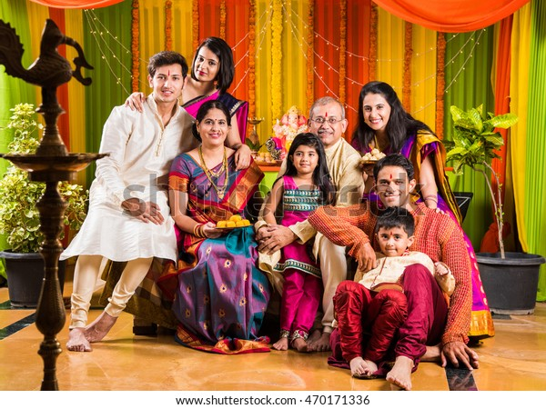 2edb86dfb4 Happy Indian Family Celebrating Ganesh Festival or Chaturthi - Welcoming or  performing Pooja and eating sweets