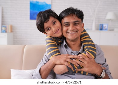 Happy Indian father hugging with his child