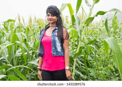 Happy Indian girl in field at morning and enjoying nature.