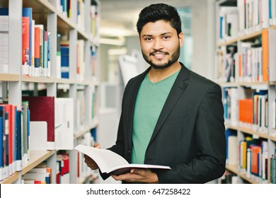 Happy indian male student at the library
